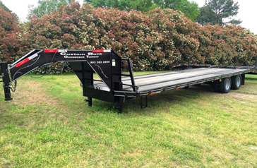30 foot Pierced Frame Stock Flatbed Heavy Duty Trailer in Sulpher Springs, Texas
