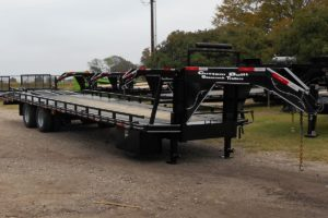 Side View of a 30 Foot, Pierced Frame Specialty Trailer built by Custom Built Gooseneck Trailers