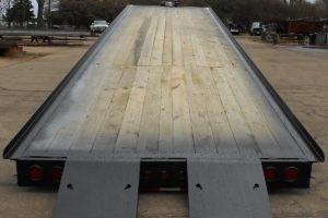 Rear View of a Black, 35 Foot, Hydraulic Gooseneck Container Hauler built by Custom Built Gooseneck Trailers