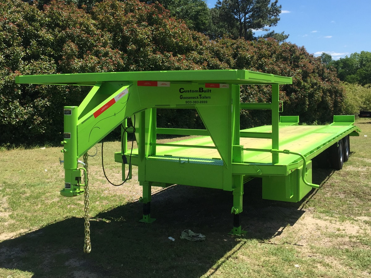 Green, 35 Foot, Pierced Frame Upper Deck Trailer with a Tool Box and HD Ramps built by Custom Built Gooseneck Trailers