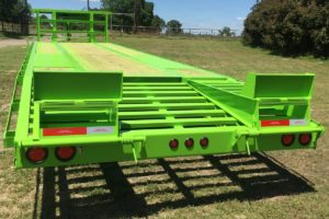 Rear View of a Green, 35 Foot, Pierced Frame Upper Deck Trailer with a Tool Box and HD Ramps built by Custom Built Gooseneck Trailers