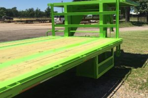 Side View of a Green, 35 Foot, Pierced Frame Upper Deck Trailer with a Tool Box and HD Ramps built by Custom Built Gooseneck Trailers