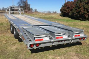 Silver, 35 Foot, Pierced Frame Gooseneck Trailer built by Custom Built Gooseneck Trailers