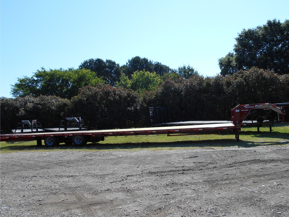 Side View of the Red, 40 Foot, Pierced Frame, Lift Axle, Air-Ride Trailer built by Custom Built Gooseneck Trailers