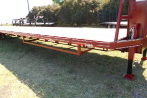 Red, 40 Foot, Pierced Frame, Lift Axle, Air-Ride Trailer built by Custom Built Gooseneck Trailers