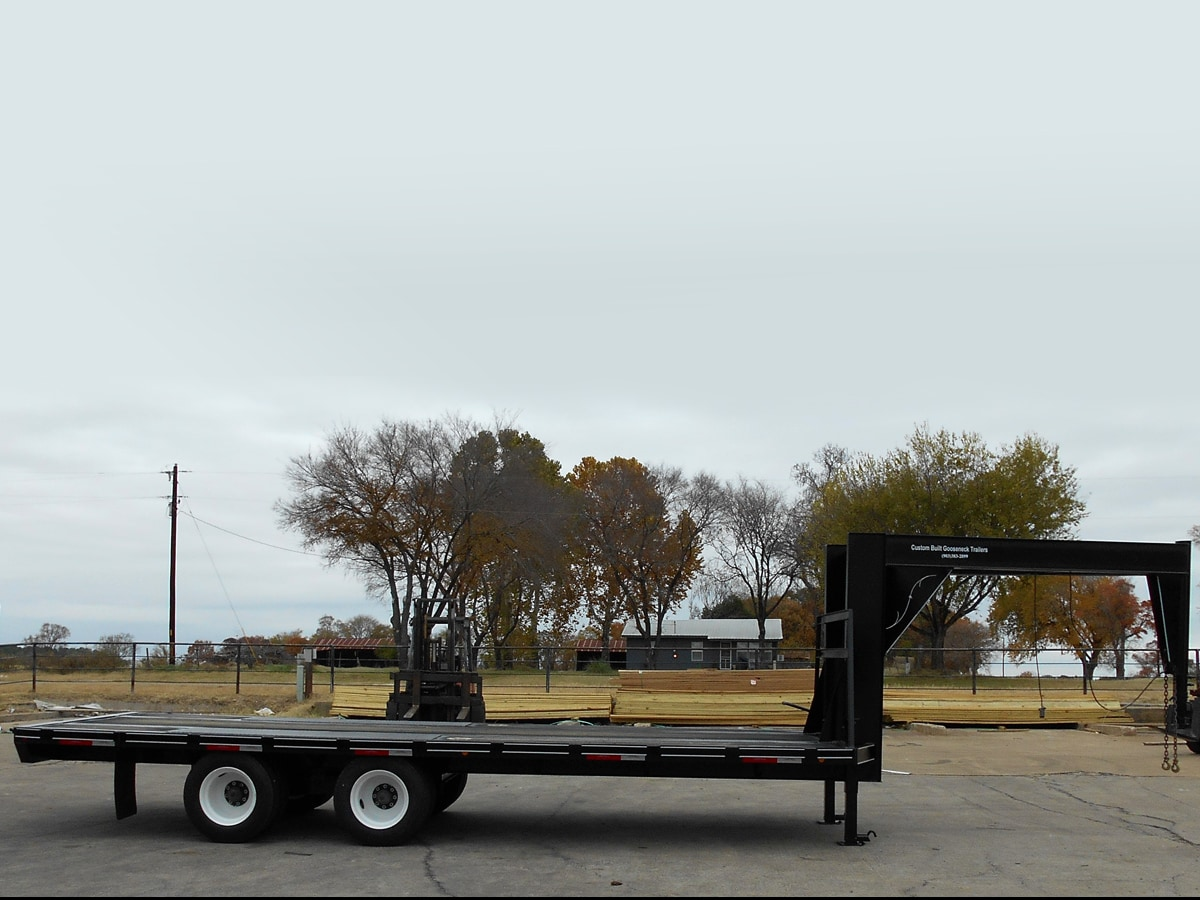 Side View of a Specialty Trailer with a Custom Tall Neck built by Custom Built Gooseneck Trailers