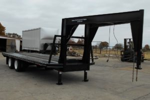 Front View of a Specialty Trailer with a Custom Tall Neck built by Custom Built Gooseneck Trailers