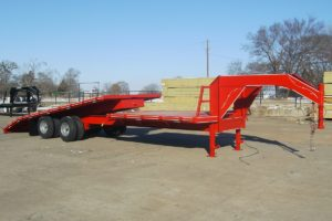 Red, Gravity Tilt Trailer built by Custom Built Gooseneck Trailers