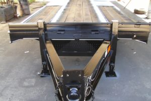 Black Pintle Hitch Trailer with Ramps built by Custom Built Gooseneck Trailers