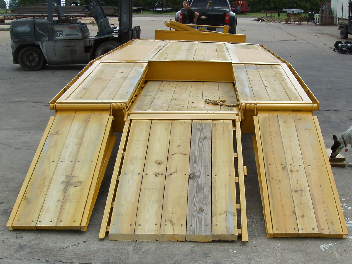 Yellow Pintle Hitch Trailer with Three Ramps built by Custom Built Gooseneck Trailers