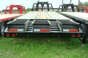 Rear View of a Trailer with Three Ramps built by Custom Built Gooseneck Trailers